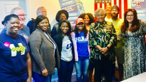 DNC Chairwoman Donna Brazile (Center-Right) joins volunteers at the HER House for a chant of #iwillvote and a photo