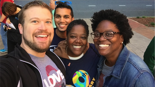 HRC staff members Ryan Wilson (left) and Hope Jackson (right) catch a selfie with openly LGBT Charlotte City Councilwoman LaWana Mayfield at the Charlotte AIDS Walk