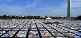 AIDS Memorial Quilt displayed over DC's National Mall