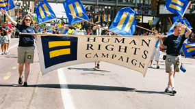 parade marchers hold HRC banner