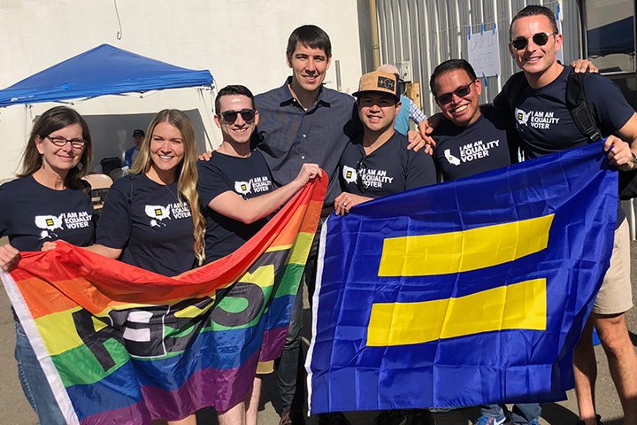 6 hrc volunteers hold an hrc flag